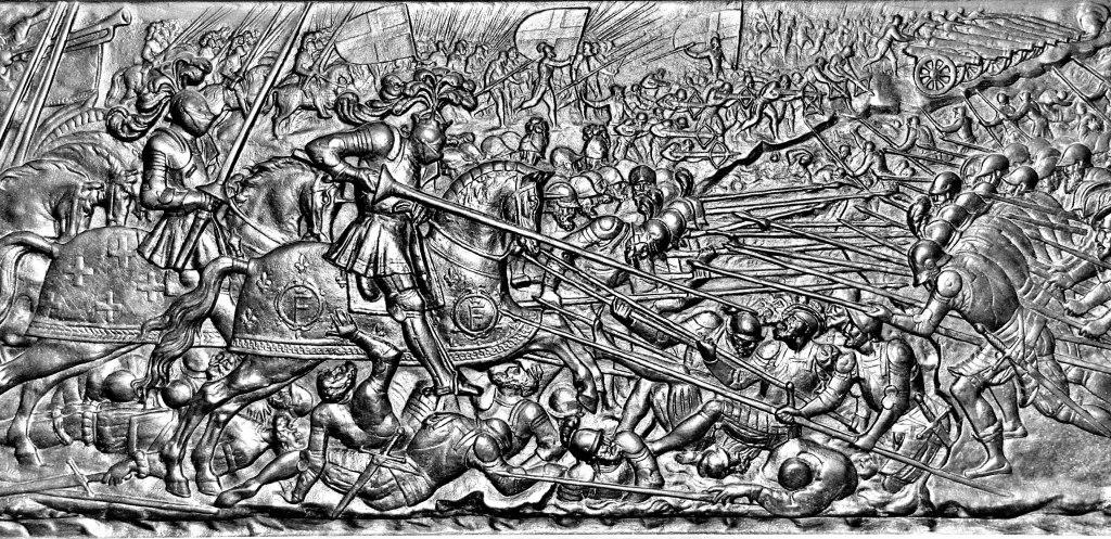 Bataille de Marignan, François Ier à la tête de la cavalerie française et emploi tactique de la pique et de la hallebarde par les Suisses contre la cavalerie française armée de la lance (Bas-relief du tombeau de François Ier, Abbaye de St-Denis, France.).